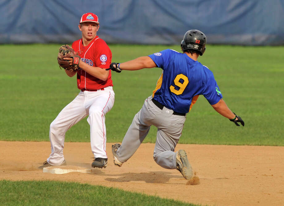 Stamford second baseman Mike Whitehead forces out Newtown's Pat Mullins during the Senior Babe Ruth State Championship game at Cubeta Stadium in Scalzi Park in Stamford on Sunday, July 21, 2013. Stamford won, 5-2. Photo: Jason Rearick / Stamford Advocate