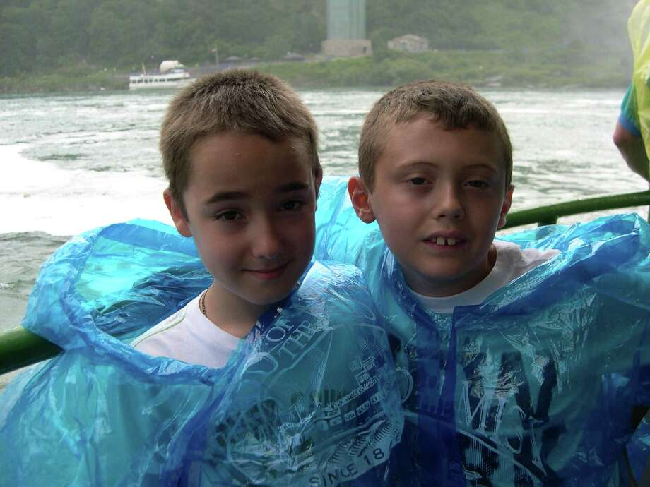 Patrick Fitzsimmons and Carson Cox, both 9, the son and grandson of Dan Fitzsimmons of Bethlehem, visited Niagara Falls, Canada, while aboard the Maid of the Mist on July 3. ?We all got very wet,? Dan says. (Dan Fitzsimmons)