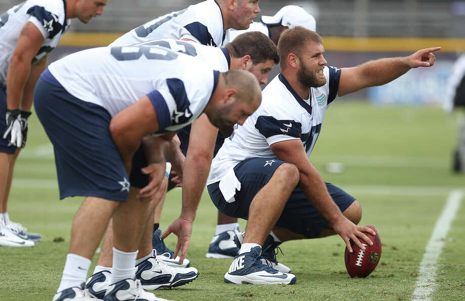 Rookie center Travis Frederick gestures during drills at the Dallas Cowboys training camp on Sunday, July 21, 2013 in Oxnard. Photo: Kin Man Hui, San Antonio Express-News / ©2013 San Antonio Express-News