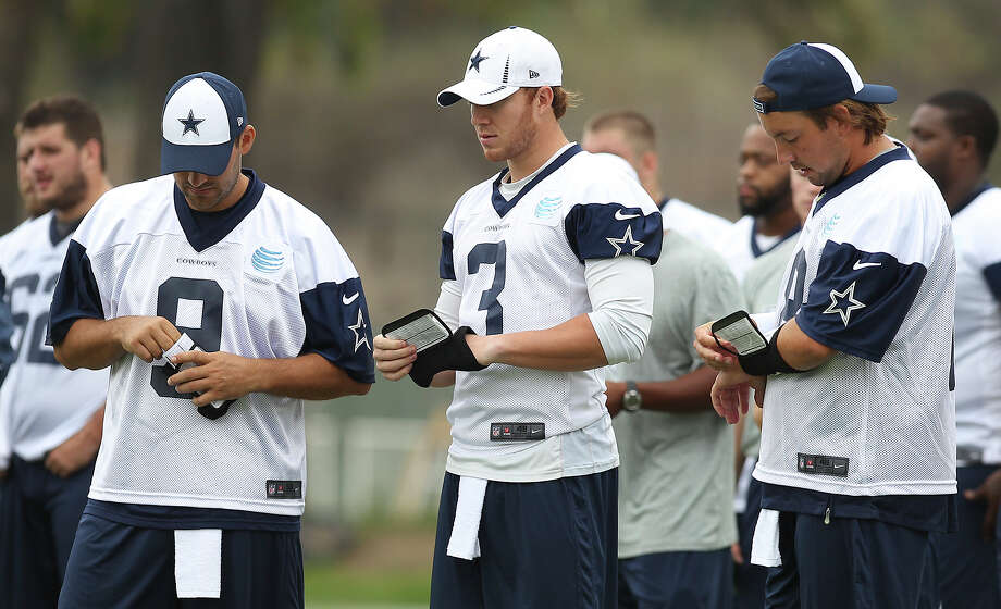 Quarterbacks Tony Romo (from left), Nick Stephens (03) and Kyle Orton (18) look over their play cards at the Dallas Cowboys training camp on Sunday, July 21, 2013 in Oxnard. Photo: Kin Man Hui, San Antonio Express-News / ©2013 San Antonio Express-News