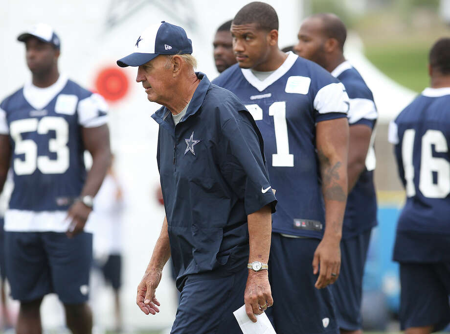 Defensive coordinator Monte Kiffin (center) oversees practice at the Dallas Cowboys training camp on Sunday, July 21, 2013 in Oxnard. Photo: Kin Man Hui, San Antonio Express-News / ©2013 San Antonio Express-News