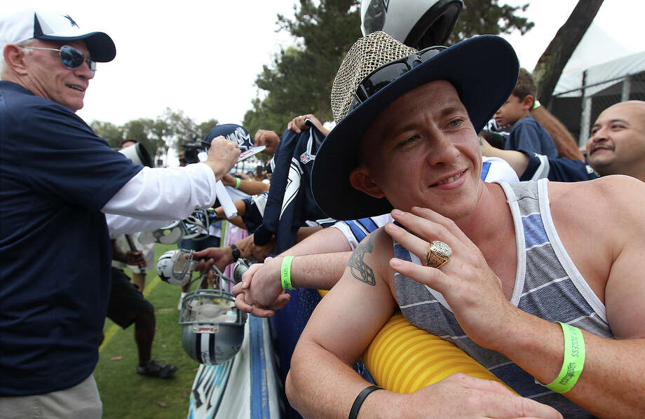 Robert Whitaker of San Jose, California gets to wear a Super Bowl ring of Jerry Jones while Jones greeted fans for the start of the 2013 Dallas Cowboys training camp on Sunday, July 21, 2013 in Oxnard. Photo: Kin Man Hui, San Antonio Express-News / ©2013 San Antonio Express-News