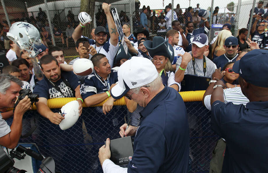 Dallas Cowboys owner Jerry Jones signs autographs for fans at the kick off the 2013 Dallas Cowboys training camp on Sunday, July 21, 2013 in Oxnard. Photo: Kin Man Hui, San Antonio Express-News / ©2013 San Antonio Express-News