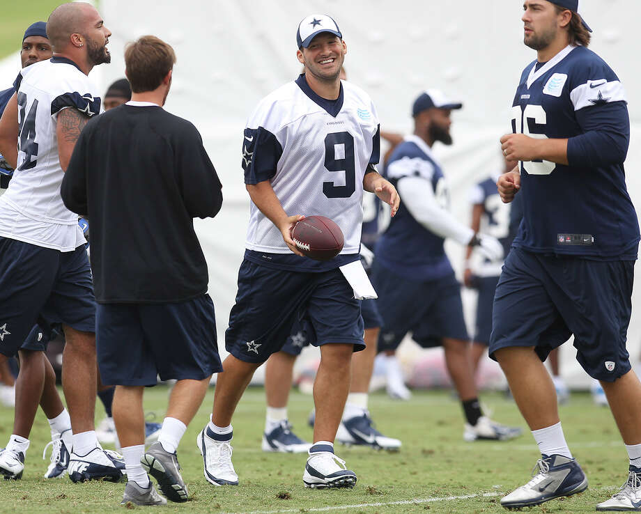 Quarterback Tony Romo reacts after a play at the Dallas Cowboys training camp on Sunday, July 21, 2013 in Oxnard. Photo: Kin Man Hui, San Antonio Express-News / ©2013 San Antonio Express-News