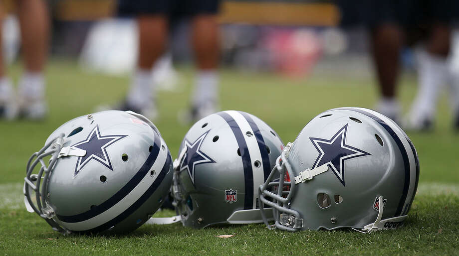 Detail of helmets at the Dallas Cowboys training camp on Sunday, July 21, 2013 in Oxnard. Photo: Kin Man Hui, San Antonio Express-News / ©2013 San Antonio Express-News