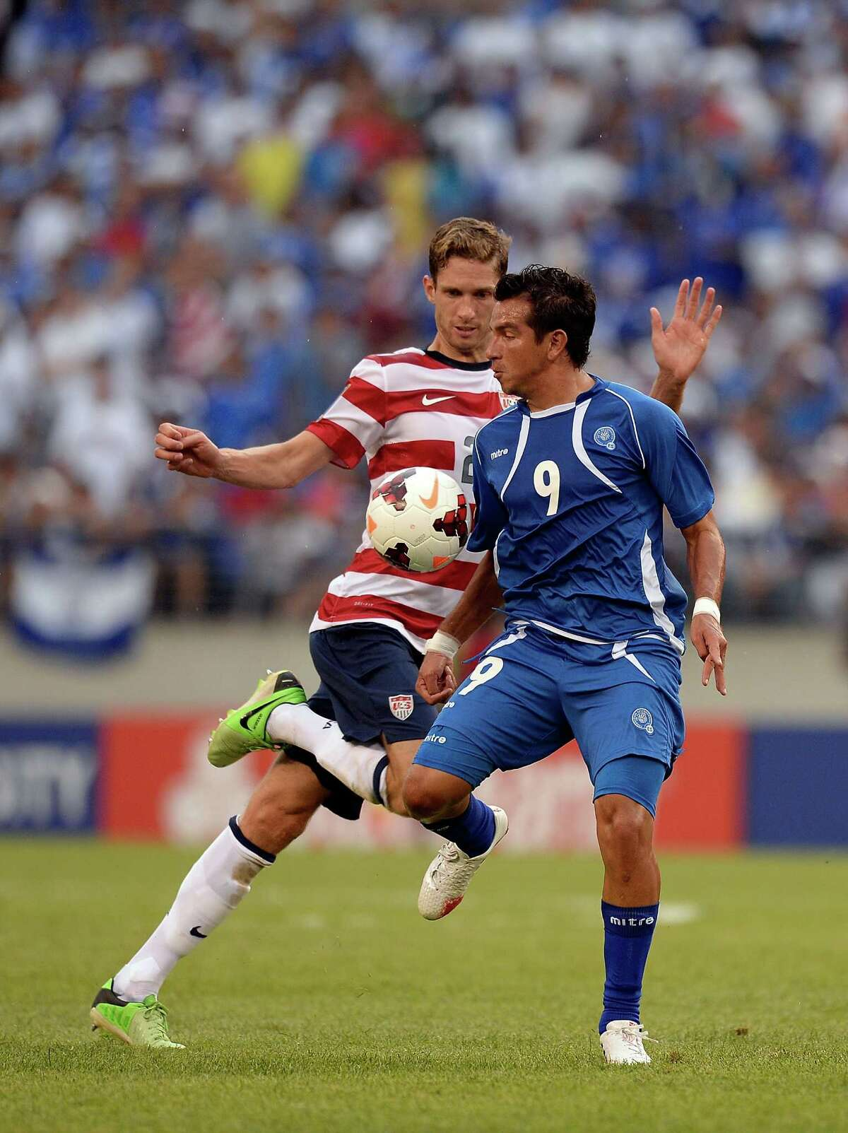 Clarence Goodson #21 of the United States battles for the ball against Rafael Burgos #9 of El Salvador in the second half during the 2013 CONCACAF Gold Cup quarterfinal game at M&T Bank Stadium on July 21, 2013 in Baltimore, Maryland.
