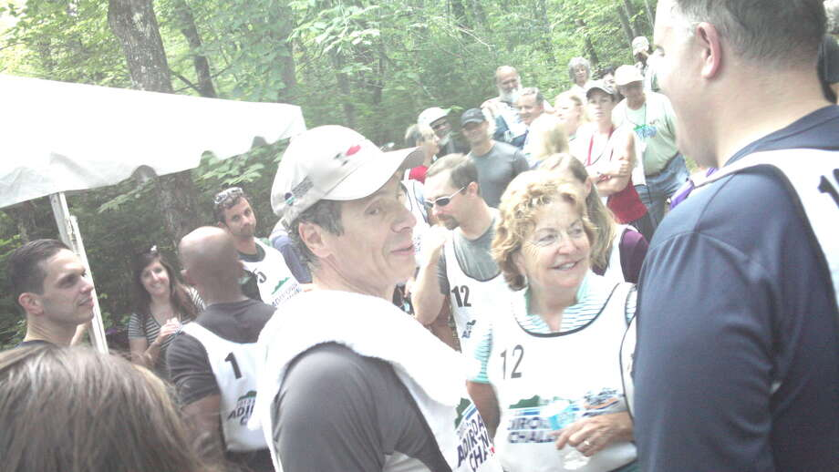 Gov. Andrew Cuomo, center, chats with Sen. Betty Little, R-Queensbury, and Assemblyman Dan Stec, R-Queensbury, after the Adirondack Challenge on Sunday, July 21, 2013. (Jimmy Vielkind/Times Union)