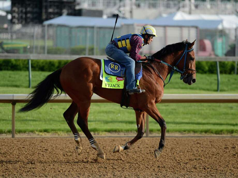 Vyjack with trainer Rudy Rodriguez in the irons works out before the Kentucky Derby May 2, 2013 in Louisville, Kentucky  (Skip Dickstein/Times Union) Photo: SKIP DICKSTEIN