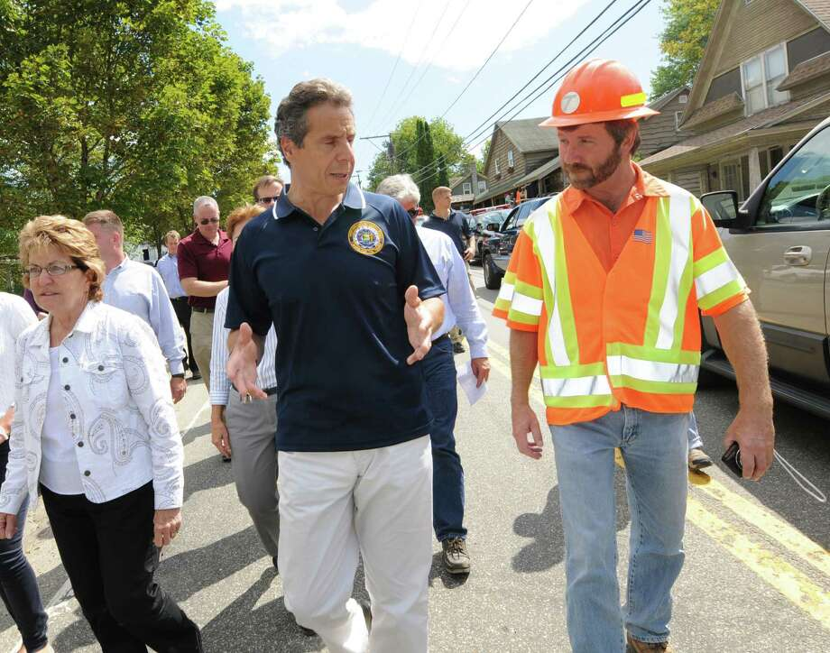 Gov. Andrew Cuomo, left, talks with NY DOT engineer Michael Fayette, right, Tuesday, Aug. 30, 2011, in Keene, N.Y. (Cindy Schultz / Times Union archive)