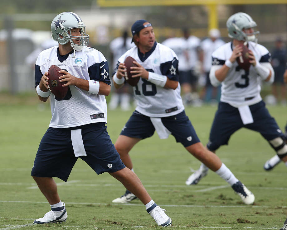 Quarterbacks Tony Romo (from left), Kyle Orton and Nick Stephens perform drills at the 2013 Dallas Cowboys training camp on Sunday, July 21, 2013 in Oxnard. Photo: Kin Man Hui, San Antonio Express-News / ©2013 San Antonio Express-News