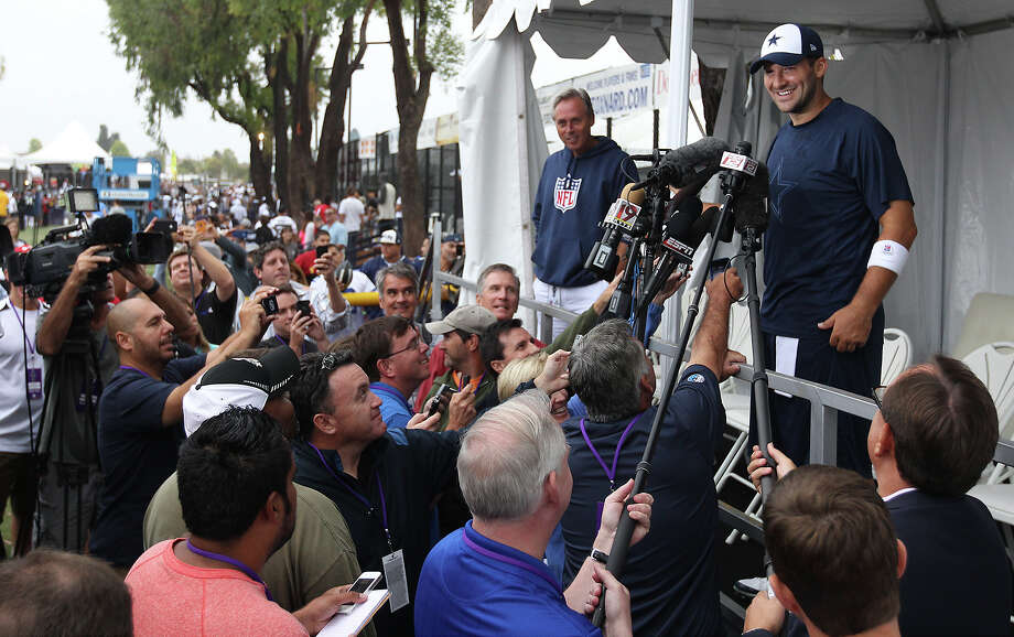 Quarterback Tony Romo takes questions from reporters at the 2013 Dallas Cowboys training camp on Sunday, July 21, 2013 in Oxnard. Photo: Kin Man Hui, San Antonio Express-News / ©2013 San Antonio Express-News