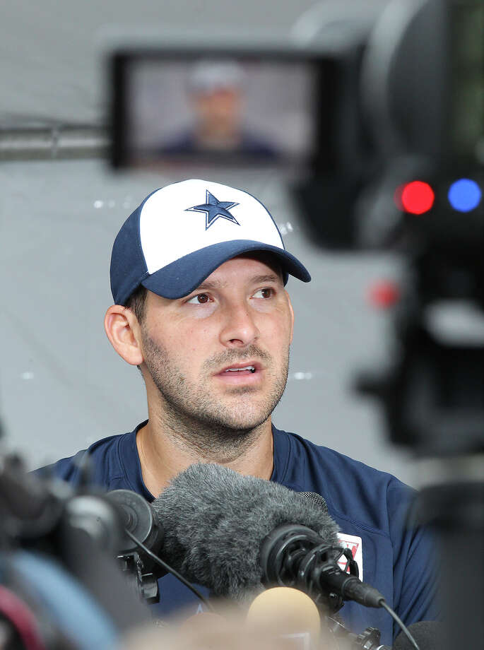 Quarterback Tony Romo fields questions after practice at the 2013 Dallas Cowboys training camp on Sunday, July 21, 2013 in Oxnard. Photo: Kin Man Hui, San Antonio Express-News / ©2013 San Antonio Express-News