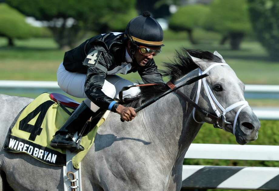 Wired Bryan with jockey Shaun Bridgmohan in the saddle overwhelmed the field of six horses the win the 99th running of The Sanford Stakes at the Saratoga Race Course   July 21, 2013 in Saratoga Springs, N.Y.   (Skip Dickstein/Times Union) Photo: SKIP DICKSTEIN
