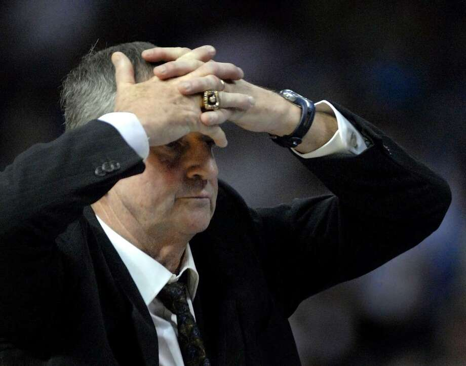 University of Connecticut head coach Jim Calhoun covers his head as his team plays San Diego in overtime during an NCAA West Regional first round tournament basketball game Friday March 21, 2008, in Tampa, Fla. San Diego upset Connecticut 70-69. Photo: Steve Nesius, AP File Photo/Steve Nesius / AP