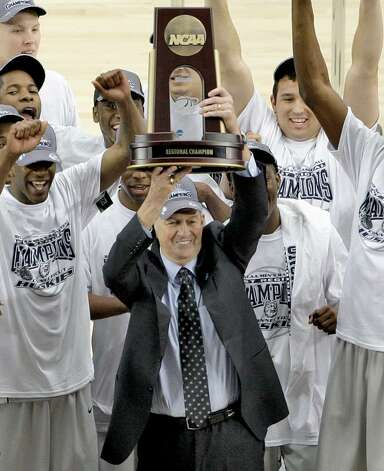 In this March 28, 2009, file photo, Connecticut coach Jim Calhoun and his players celebrate their 82-75 win over Missouri in a men's NCAA college basketball tournament regional final in Glendale, Ariz. Calhoun is taking a leave of absence to deal with undisclosed medical issues. Photo: Matt York, AP Photo/Matt York, File / AP2009