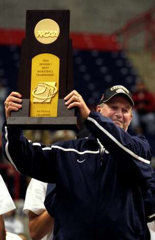 University of Connecticut head basketball coach Jim Calhoun proudly shows off  the NCAA Championship trophy during a rally at Gampiel Pavillion, in Storrs, Conn. on April 6th, 2004. Photo: File Photo / Greenwich Time File Photo