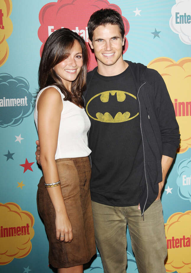 Robbie Amell (R) and Italia Ricci arrive at the Entertainment Weekly's Annual Comic-Con celebration held at Float at Hard Rock Hotel San Diego on July 20, 2013 in San Diego. Photo: Michael Tran, FilmMagic / Getty Images