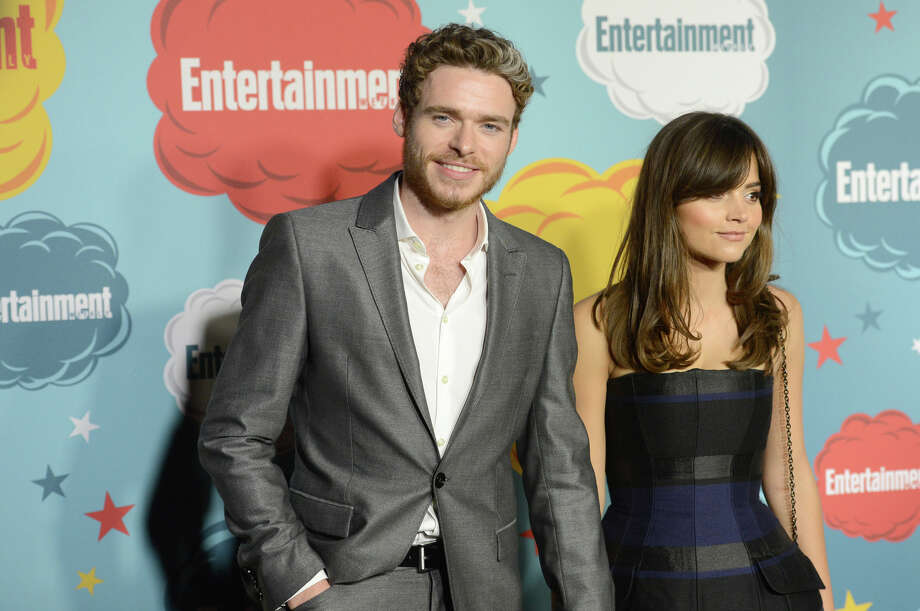 Actor Richard Madden (L) and Jenna Louise Coleman attend Entertainment Weekly's Annual Comic-Con Celebration at Float at Hard Rock Hotel San Diego on July 20, 2013 in San Diego. Photo: Jason Merritt, Getty Images / Getty Images