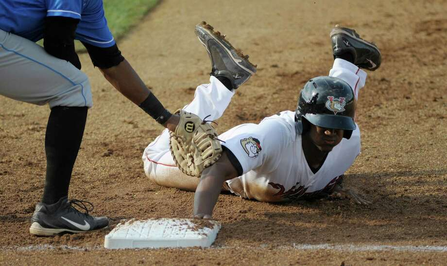 Ronnie Mitchell of the ValleyCats slides safely back into first base during the ValleyCats and Hudson Valley baseball game on Sunday, July 21, 2013 in Troy, NY.     (Paul Buckowski / Times Union) Photo: Paul Buckowski / 00023165A