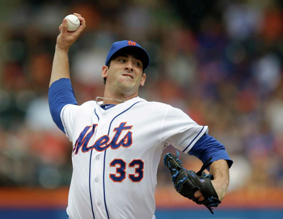 New York Mets starting pitcher Matt Harvey winds up against the Philadelphia Phillies during the first inning of a baseball game on Sunday, July 21, 2013, in New York. (AP Photo/Kathy Willens) ORG XMIT: NYM103 Photo: Kathy Willens / AP