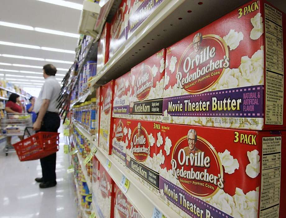 Orville Redenbacher brand popcorn is seen on shelves at a market in Omaha, Neb., Wednesday, Sept. 5, 2007. The nation's largest microwave popcorn maker, ConAgra Foods Inc., said Wednesday it will change the recipe for its Orville Redenbacher and Act II brands over the next year to remove a flavoring chemical linked to a lung ailment in popcorn plant workers. (AP Photo/Nati Harnik) Ran on: 09-06-2007 The makers of microwave popcorn will remove a common butter-flavor chemical for the safety of their factory workers. Diacetyl recently caused popcorn lung in a consumer. ALSO Ran on: 11-11-2007 Orville Redenbacher brand popcorn is stacked on shelves at a market; diacetyl, a chemical that gives foods a buttery taste, has been used in microwave popcorn and has been linked to a rare, irreversible lung disease. Photo: Nati Harnik, AP