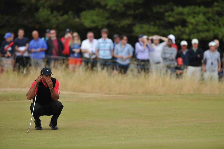 GULLANE, SCOTLAND - JULY 21:  Tiger Woods of the United States lines up a putt on the 6th hole during the final round of the 142nd Open Championship at Muirfield on July 21, 2013 in Gullane, Scotland. Photo: Stuart Franklin, Getty Images / 2013 Getty Images