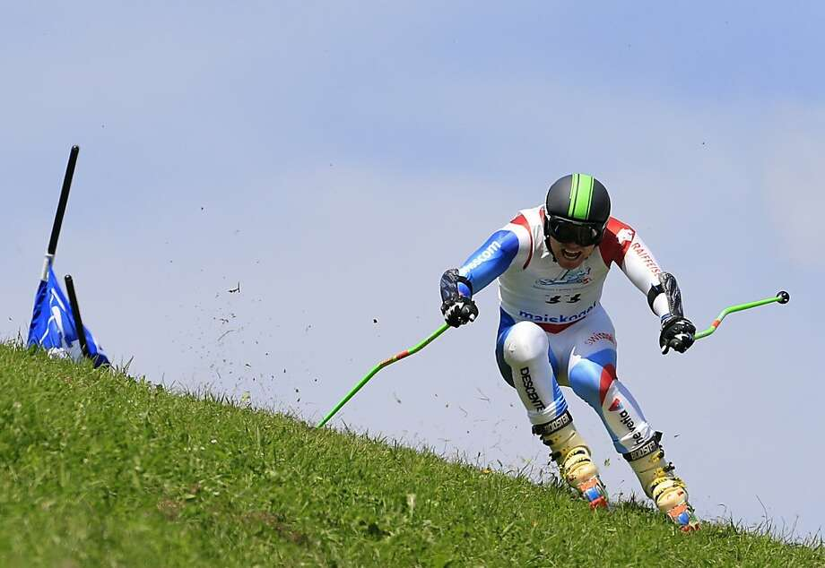 Watch out for the bare spots!Stefan Portmann races in the Super   Combined Giant Slalom during the FIS Grass Ski World Cup competition in Kaprun,   Switzerland. Photo: Alexander Klein, AFP/Getty Images