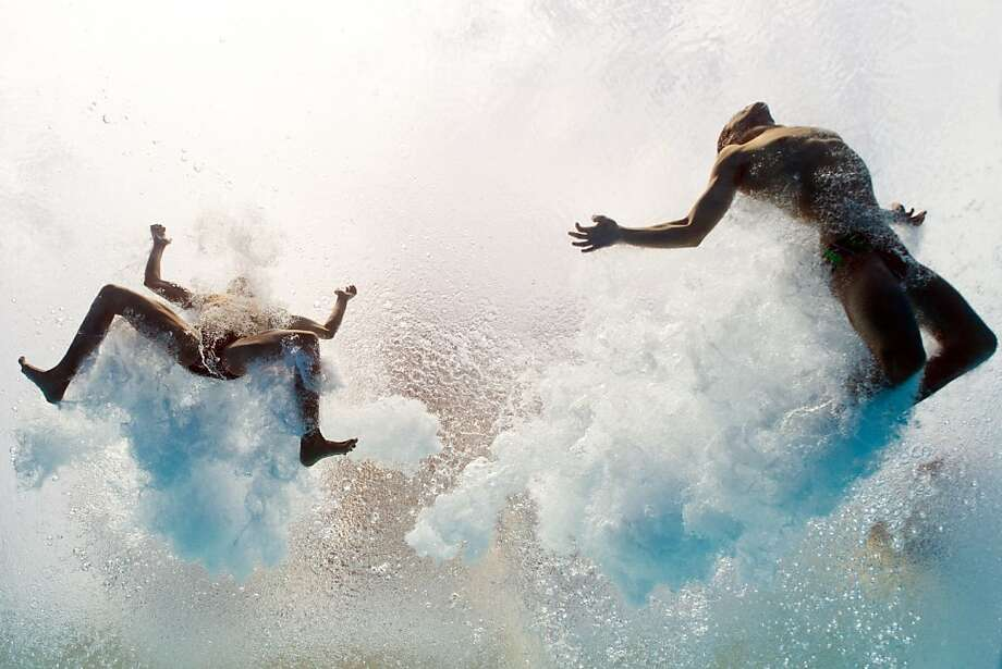 TOPSHOTS In a picture taken with an underwater camera Mexico's Ivan Garcia and German Sanchez enter the water as they compete in the men's 10-metre synchro platform preliminary diving event in the FINA World Championships at the Piscina Municipal de Montjuic in Barcelona on July 21, 2013. AFP PHOTO / FRANCOIS XAVIER MARITFRANCOIS XAVIER MARIT/AFP/Getty Images Photo: Francois Xavier Marit, AFP/Getty Images