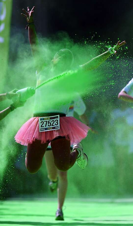 *** BESTPIX *** COLOGNE, GERMANY - JULY 21:  Competitors run through the green colour throw area during the Color Run on July 21, 2013 in Cologne, Germany.  (Photo by Lars Baron/Bongarts/Getty Images) Photo: Lars Baron, Bongarts/Getty Images