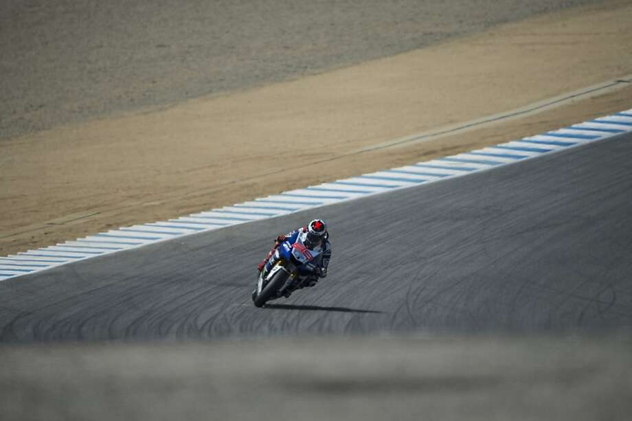 MONTEREY, CA - JULY 21:   Jorge Lorenzo of Spain and Yamaha Factory Racing rounds the bend during the MotoGP race during the MotoGp Red Bull U.S. Grand Prix - Race at Mazda Raceway Laguna Seca on July 21, 2013 in Monterey, California.  (Photo by Getty Images/Getty Images) Photo: Getty Images