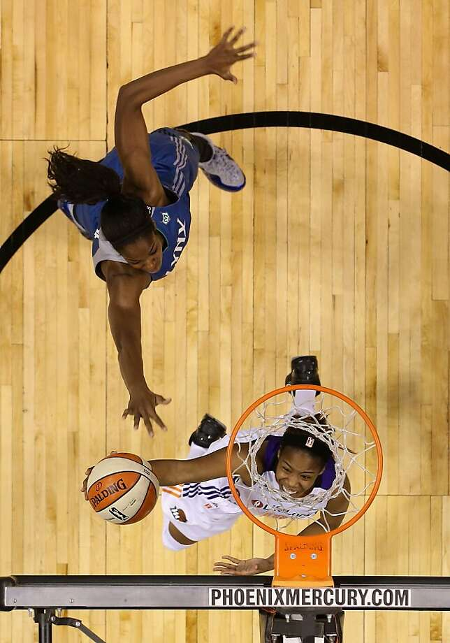 PHOENIX, AZ - JULY 21:  Jasmine James #10 of the Phoenix Mercury lays up a shot past Devereaux Peters #14 of the Minnesota Lynx during the second half of the WNBA game at US Airways Center on July 21, 2013 in Phoenix, Arizona.  The Lynx defeated the Mercury 82-77.  NOTE TO USER: User expressly acknowledges and agrees that, by downloading and or using this photograph, User is consenting to the terms and conditions of the Getty Images License Agreement.  (Photo by Christian Petersen/Getty Images) Photo: Christian Petersen, Getty Images