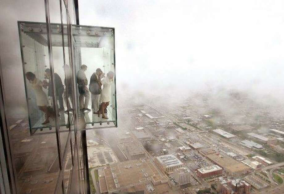 Would this have been cool in Seattle? Here's a viewing cube in Chicago's Willis Tower, installed in 2009 at 1,353 feet off the ground. Photo: Scott Olson / Getty Images