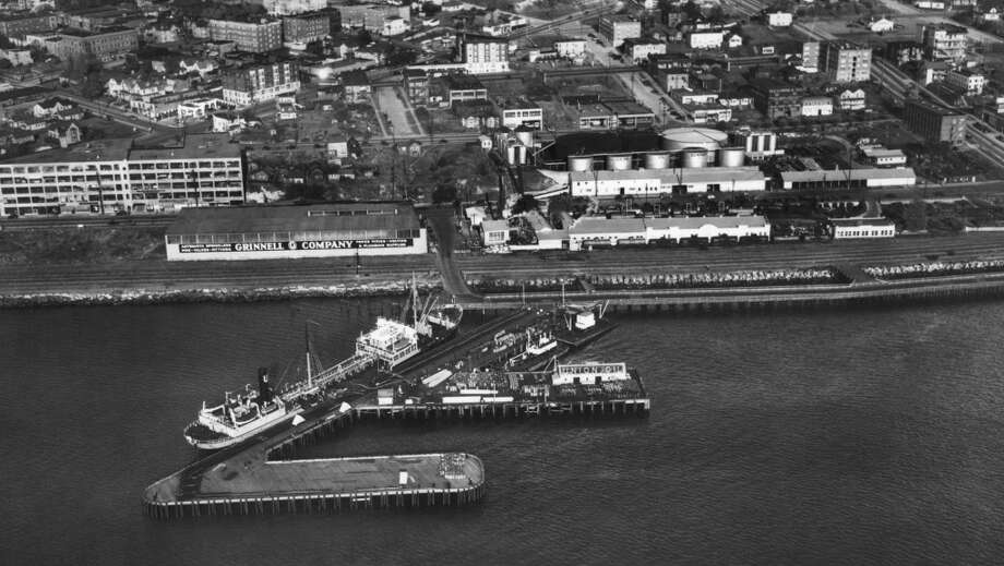 Then a crazy waterfront idea: To turn this longtime, contaminated, industrial stretch along Elliott Bay into something green, pretty and public.   This is what the Olympic Sculpture Park site looked like for decades, when it was a fuel dock. Photo: P-I File, PEMCO Webster & Stevens Collection, Museum of History & Industry.
