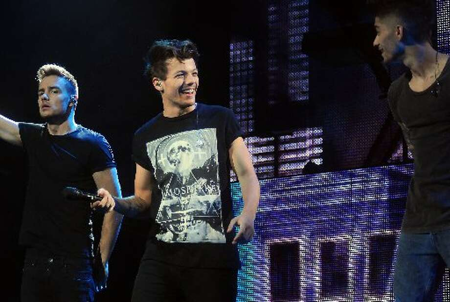 Louis Tomlinson of One Direction jokes around during their sold out show at Toyota Center Sunday July 21, 2013. Photo: Dave Rossman/For The Chronicle