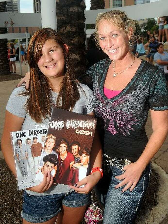 Fans await the sold-out One Direction concert outside the Toyota Center Sunday July 21, 2013. Photo: Dave Rossman/For The Chronicle