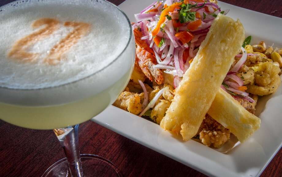 The crispy fried Calamari with a Pisco Sour at Puerto 27 in Pacifica.