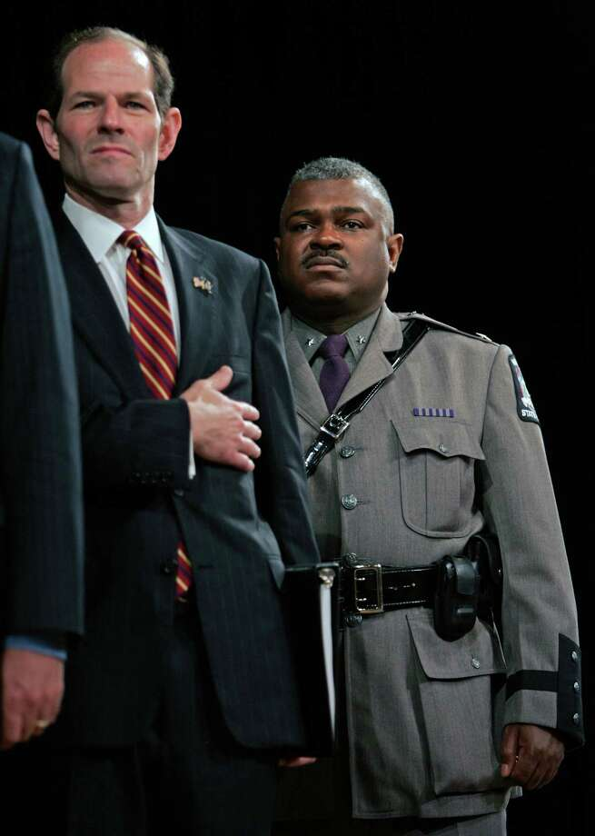 Former New York Gov. Eliot Spitzer, left, directed State Police to leave his hotel room floor at night. Preston Felton, right, former acting superintendent of the New York State Police, declined to cooperate with a 2009 Attorney General's investigation that examined whether State Police were aware of Spitzer's use of prostitutes. (AP Photo/Mike Groll, file) Photo: Mike Groll / AP