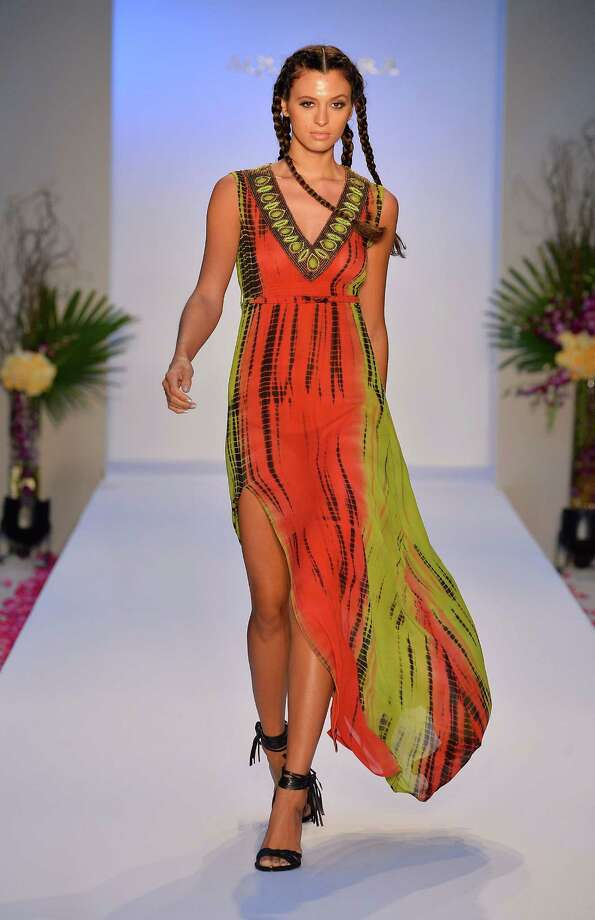 MIAMI BEACH, FL - JULY 20:  A model walks the runway at the Aqua Di Lara show during Mercedes-Benz Fashion Week Swim 2014 at the Raleigh on July 20, 2013 in Miami Beach, Florida. Photo: Frazer Harrison, Getty Images For Mercedes-Benz / 2013 Getty Images