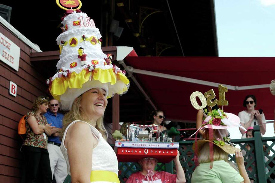 Annemarie Mitchell, from Stillwater, wears her hat she made for the Uniquely Saratoga category during the Hats off to Saratoga festival at the Saratoga Race Course on Sunday, July 21, 2013 in Saratoga Springs, NY.   (Paul Buckowski / Times Union) Photo: Paul Buckowski, Albany Times Union / 00023238A