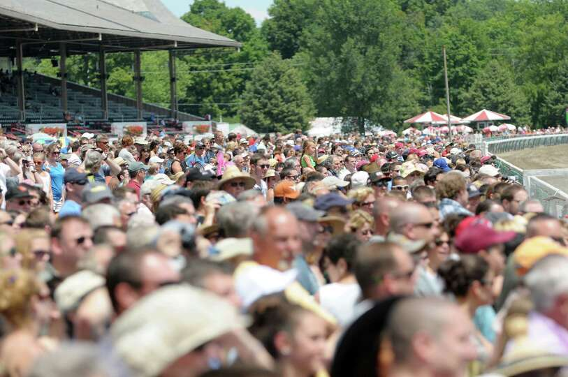 Visitors to the Saratoga Race Course watch the races on Sunday, July 21, 2013 in Saratoga Springs, N
