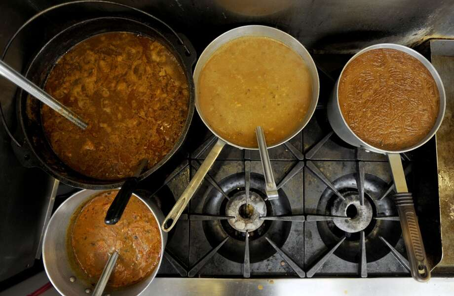 From left, beef tips, chicken and sausage gumbo, shrimp etouffee and, bottom, crawfish etouffee on the gas stove at Vautrot's Cajun Cuisine on Texas 105.