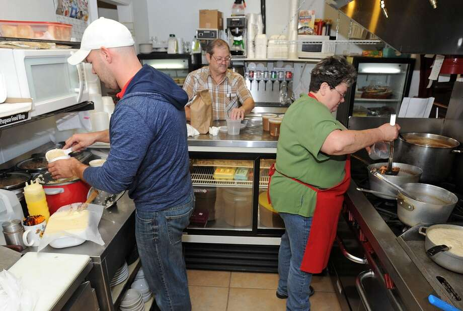 From left, Nicholas, Louis and Martha Vautrot work in the kitchen at Vautrot's restaurant on Highway 105.  Photo taken Wednesday, October 31, 2012 Guiseppe Barranco/The Enterprise Photo: Guiseppe Barranco, Guiseppe Barranco/The Enterprise