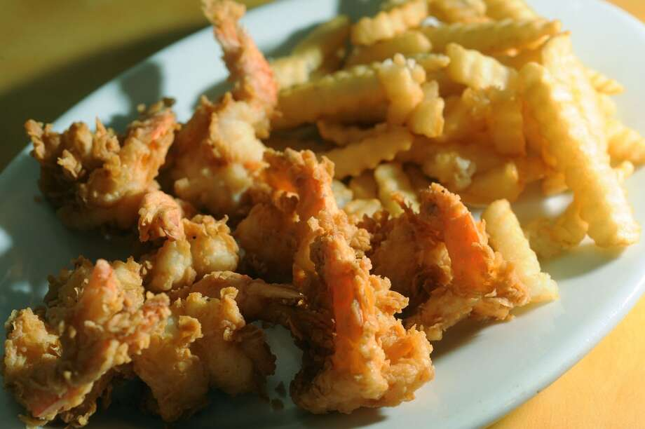 Fried shrimp and fries at Vautrot's Cajun Cuisine in Bevil Oaks Photo taken Tuesday, July 09, 2013 Guiseppe Barranco/The Enterprise Photo: Guiseppe Barranco, Guiseppe Barranco/The Enterprise