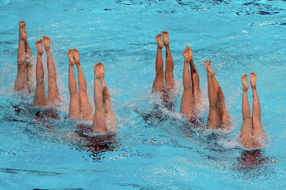 Japan's synchronized swimming team compete in the team free combination preliminary round during the synchronized swimming competition in the FINA World Championships at the Palau Sant Jordi in Barcelona, on July 21, 2013. Photo: JAVIER SORIANO, AFP/Getty Images / 2013 AFP