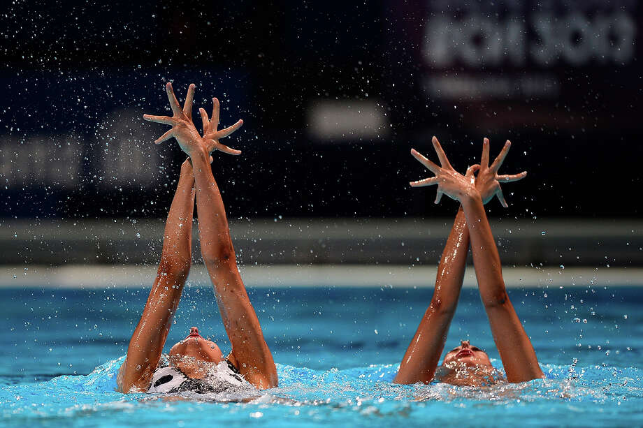 Margalida Crespi Jaume and Spain's  Ona Carbonell Ballestero  compete in the duet technical final during the synchronized swimming competition in the FINA World Championships at the Palau Sant Jordi in Barcelona, on July 21, 2013. Photo: JAVIER SORIANO, AFP/Getty Images / 2013 AFP