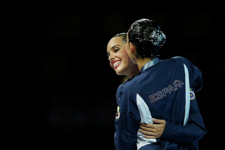 (L-R) Bronze medallists Carbonell Ballestero and Margalida Crespi Jaume of Spain celebrate after the Synchronized Swimming Duet Technical final on day two of the 15th FINA World Championships at Palau Sant Jordi on July 21, 2013 in Barcelona. Photo: Quinn Rooney, Getty Images / 2013 Getty Images