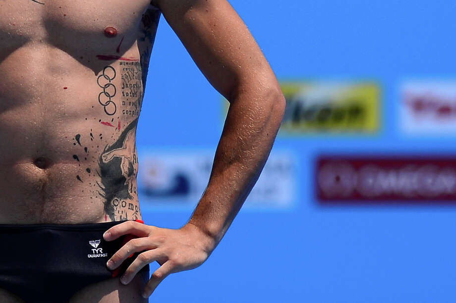 France's Matthieu Rosset prepares to dive in the men's 1-metre springboard final diving event in the FINA World Championships at the Piscina Municipal de Montjuic in Barcelona on July 22, 2013. Photo: JAVIER SORIANO, AFP/Getty Images / 2013 AFP