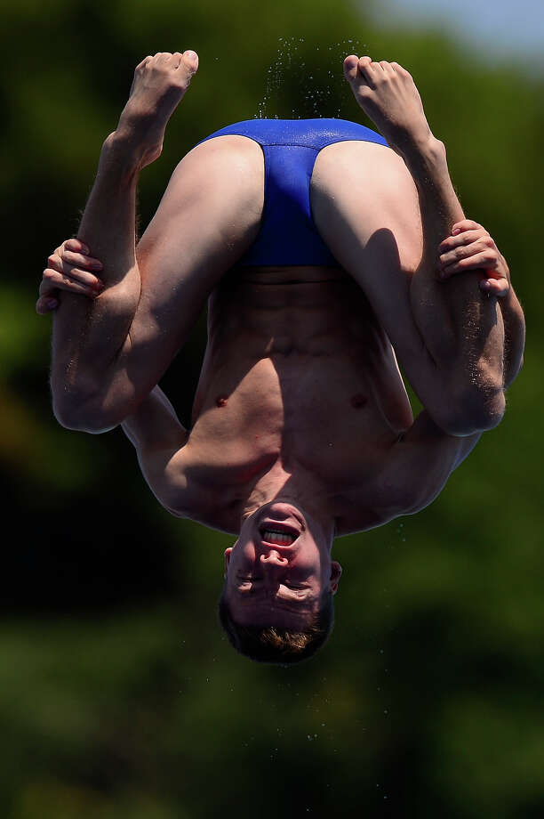Germany's Martin Wolfram competes in the men's 1-metre springboard final diving event in the FINA World Championships at the Piscina Municipal de Montjuic in Barcelona on July 22, 2013. Photo: JAVIER SORIANO, AFP/Getty Images / 2013 AFP