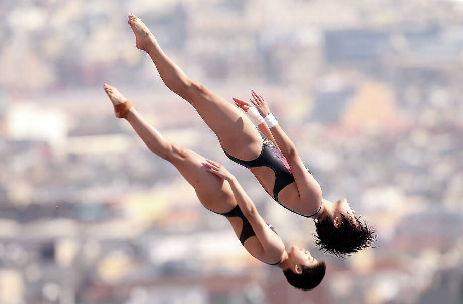 Huixia Liu and Ruolin Chen of China compete in the preliminary round of The Women's 10m Syncro Platform at The Piscina Municipal De Montjuic on day three of the 15th FINA World Championships on July 22, 2013 in Barcelona. Photo: Ian MacNicol, Getty Images / 2013 Ian MacNicol