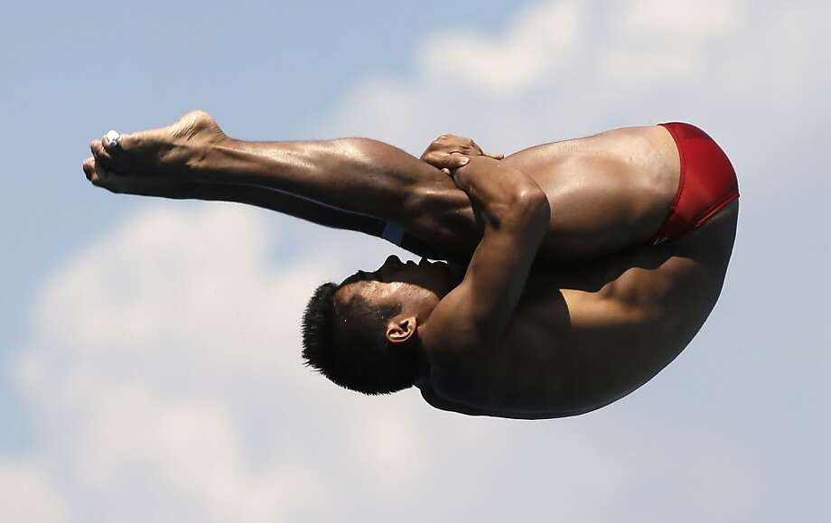 Alejandro Chavez of Mexico competes in the men's 1-meter springboard final. Photo: David J. Phillip, Associated Press